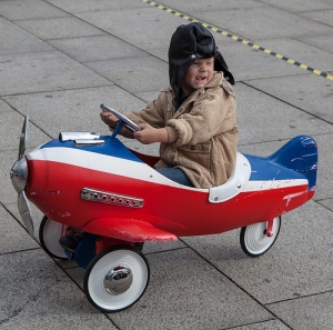 boy in toy plane