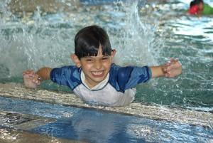 splashing in pool